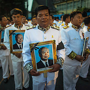 Cambodian mourners hold portraits of former Cambodian King Norodom Sihanouk as they wait for funeral procession ceremonies to begin Friday, Feb. 1, 2013 in Phnom Penh. The royal cremation ceremony for former Cambodian King Norodom Sihanouk is scheduled on 04 February 2013, after he died on 15 October 2012 in Beijing, China, at the age of 89..