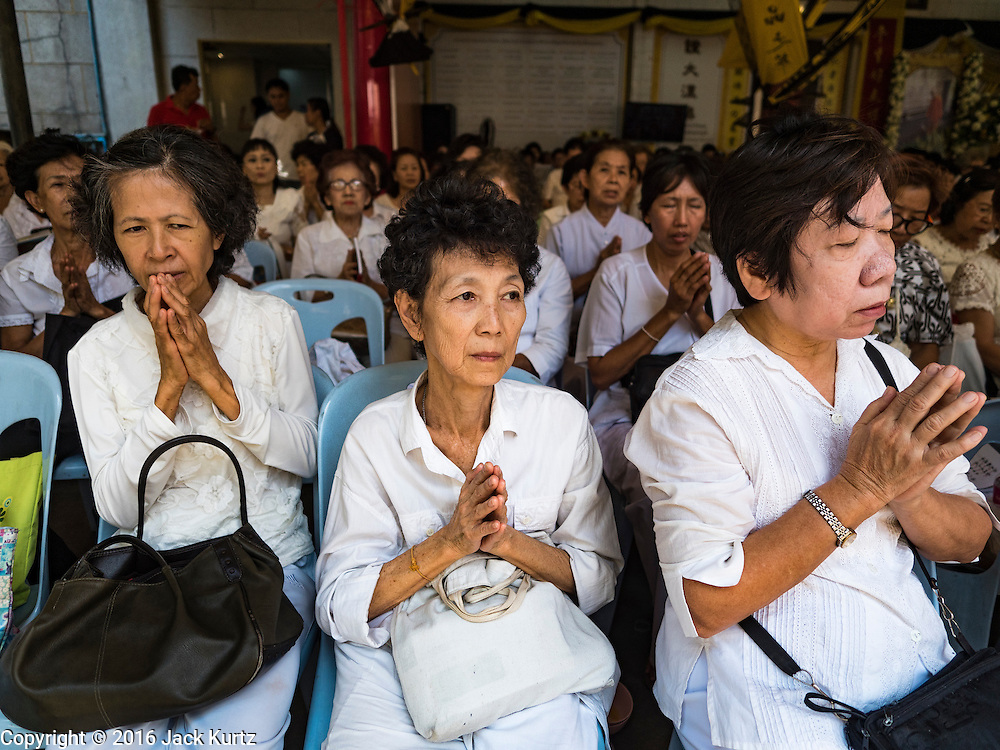 "31 JANUARY 2016 - BANGKOK, THAILAND: People participate in a prayer service before Chinese New Year at Wat Mangon Kamlawat, the largest Mahayana (Chinese) Buddhist temple in Bangkok. Thailand has the largest overseas Chinese population in the world; about 14 percent of Thais are of Chinese ancestry and some Chinese holidays, especially Chinese New Year, are widely celebrated in Thailand. Chinese New Year, also called Lunar New Year or Tet (in Vietnamese communities) starts Monday February 8. The coming year will be the ""Year of the Monkey.""            PHOTO BY JACK KURTZ"