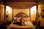 "Sex worker Riley Minx poses for a portrait in the ""Italian"" suite at the Mustang Ranch in Sparks, Nev. November 26, 2012."