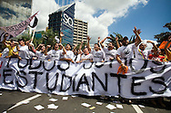 Venezuelan students take part in a campaign rally against Venezuelan President Hugo Chavez's proposal of constitutional changes in Caracas, February 7, 2009. Venezuelans will vote on February 15 on proposed changes to the constitution allowing Chavez and other politicians to stay in office as long as they keep winning elections. (Photo/Ivan Gonzalez)