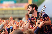 Yannis Philippakis of the Foals performs live on the main stage during day two of Reading Festival at Richfield Avenue on August 24, 2013 in Reading, England.  (Photo by Simone Joyner)