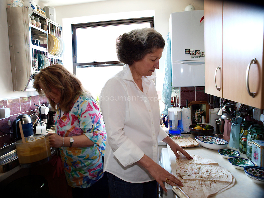 Lebanese Chef Anissa Helou (right) and Palestinian singer Reem Kelani preparing a Palestinian meal in Reem's house in London.