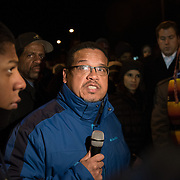US Congressman Keith Ellison speaks to protesters with the Black Lives Matter movement as they gathered for a night of community and protest outside the Minneapolis Police Department 4th precinct headquarters on Thursday, November 19, 2015 in Minneapolis, Minnesota. <br /> <br /> A more mellow and festive atmosphere, with a smaller police presence, prevailed after Wednesday evening's tear gas clashes between police and protesters. <br /> <br /> Protests and an encampment at the site have been ongoing since the police shooting of 24-year-old Jamar Clark by Minneapolis Police on Sunday, November 15. <br /> <br /> <br /> Photo by Angela Jimenez for Minnesota Public Radio www.angelajimenezphotography.com
