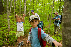 A family explores a woodland trail at Highland Farm in York, Maine.