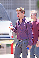 """July 13th, 2010 Los Angeles, CA. ***EXCLUSIVE*** Ryan Phillippe arrives on to the set of """"The Lincoln Lawyer"""" with what appears to be a wardrobe malfunction with the fly of his pants which kept flapping open as he walked. Wardrobe department personnel were later seen adjusting Ryan's trousers before he filmed a scene inside an apartment building. Ryan Phillippe co stars with Matthew McConaughey in """"The Lincoln Lawyer"""" about a lawyer who conducts business from the back of his Lincoln town car .Photo by Eric Ford/On Location News 818-613-3955 info@onlocationnews.com"""
