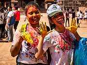 12 MARCH 2017 - BHAKTAPUR, NEPAL: Nepali girls with Holi powder on them at a Holi celebration in Bhaktapur. Holi, a Hindu religious festival, has become popular with non-Hindus in many parts of South Asia, as well as people of other communities outside Asia. The festival signifies the victory of good over evil, the arrival of spring, end of winter, and for many a festive day to meet others. Holi celebrations in Nepal are not as wild as they are in India.     PHOTO BY JACK KURTZ