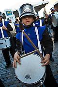 Marching bands parade through the streets of Old San Juan during the Festival of San Sebastian in San Juan, Puerto Rico.