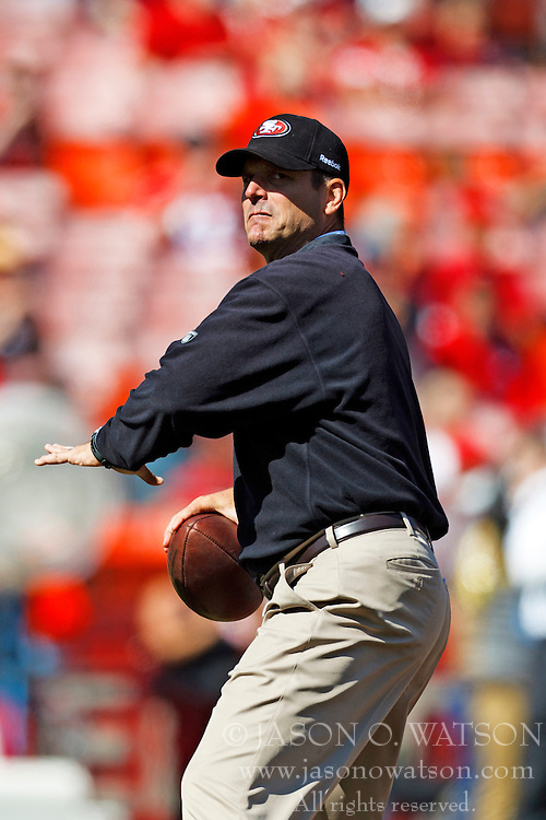 Oct 9, 2011; San Francisco, CA, USA; San Francisco 49ers head coach Jim Harbaugh passes the ball during warm ups before the game against the Tampa Bay Buccaneers at Candlestick Park. San Francisco defeated Tampa Bay 48-3. Mandatory Credit: Jason O. Watson-US PRESSWIRE