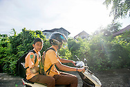 At left, Feri rides to school with his friend and classmate, Muhammed Iqbal, on November 21, 2014 in Banda Aceh, Indonesia. Ann Hermes/© The Christian Science Monitor 2014