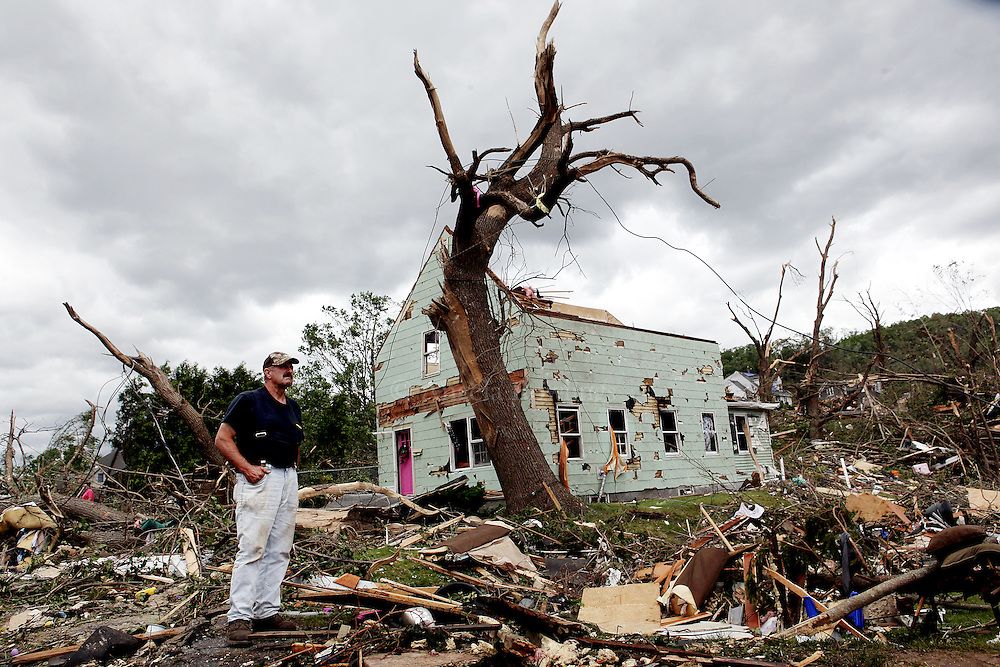 (060211  Monson, MA) Volunteer Peter Lloyd stands outside a tornado-damaged home on Bethany Road as he waits to clear branches, Thursday,  June 02, 2011.  Staff photo by Angela Rowlings.