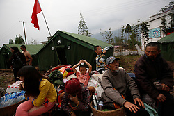 Chinese residents affected by the earthquake are seen in temporary shelter in Longmen Village of Lushan County, Sichuan Province, China, 22 April 2013. The Lushan Earthquake in Sichuan Province on 20 April 2013 resulted in 186 people dead, 21 missing, 11248 injured. About 1.72 million people were affected by the quake, while an initial estimate by the International Red Cross on Saturday put the number needing emergency shelter, water and food at 120,000. The China Earthquake Administration (CEA) recorded a magnitude 7.0 earthquake, while the US Geological Survey said it had measured 6.9.