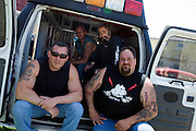 "Rescue Ink, Long Island, New York, taettowierte Motoradgang, Verein zur Rettung mishandelter Hunde und anderer Tierarten.vlnr:.Joe Panz, Jonny ""O"", ""Batzo"", ""Big Ant"", in ihrem Krankenwagen.Rescue Ink, the animal rescue group that brings an in your face approach to the fight against animal abuse and neglect. The goups members are heavily tattooed and ride motorbikes. Their pitbull 'Rebel', who lives at their headquarters, was rescued from a dog fighting operation, where he was used as bait. He was near death when two members of Rescue Ink flew to Virginia to save him...Foto © Stefan Falke."
