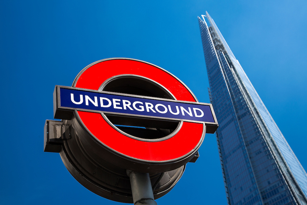 Transport for London underground station sign at London Bridge with The Shard in the background. Selective focus on the sign. The Shard is the tallest building in Western Europe and is fast becoming a tourist hot-spot due to its outstanding views over London. London Bridge is serviced by London Underground's Jubilee Line.