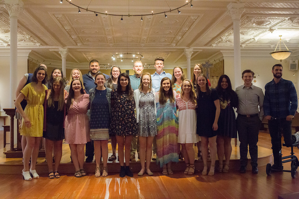 Graduates of the 2017 social justice missioning ceremony pose for a picture on May 12. The event took place in the Student Chapel in College Hall, led by keynote speaker Tyler Hobbs, and included the official pinning for senior social justice students.<br /> Photo by Libby Kamrowski