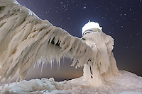 An ice-encased St. Joseph Lighthouse during a clear January night.