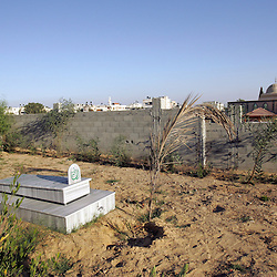 The grave of Yosra Arafat, the sister of Yasser Arafat, sits alone in the Al Shohada Cemetery, Gaza, Palestinian Territories, Nov. 9, 2004. There is much speculation on the burial place of Arafat, though Israel has stated they want it to be in Gaza. Sheikh Ahmed Yassin is also buried at this cemetery.