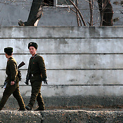 Two North Korean soldiers patrol in the bank of the Yalu river in Sinuiju, North Korea, on Thursday, Feb. 8, 2007. The Six Party talks have started on the 8th of February in Beijing with the hope of terminating the nuclear program of North Korea