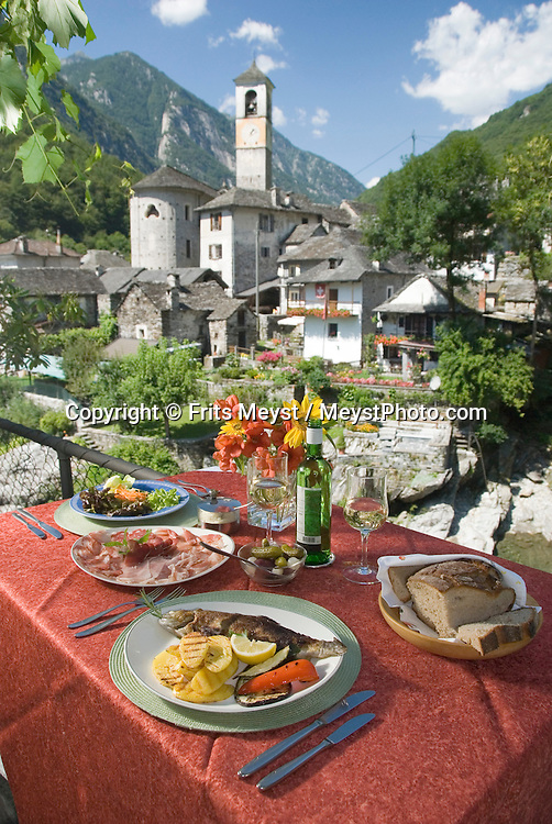 Lavertezzo, Ticino, Switzerland, August 2009. Local cuisine in Osteria Vittoria in Lavertezzo. The Valle Verzasca valley offers a spectacular rocky gorge with turquoise waters and a roman bridge. Ticino is the subtropical canton of switzerland where Italian is the first language. Photo by Frits Meyst/Adventure4ever.com