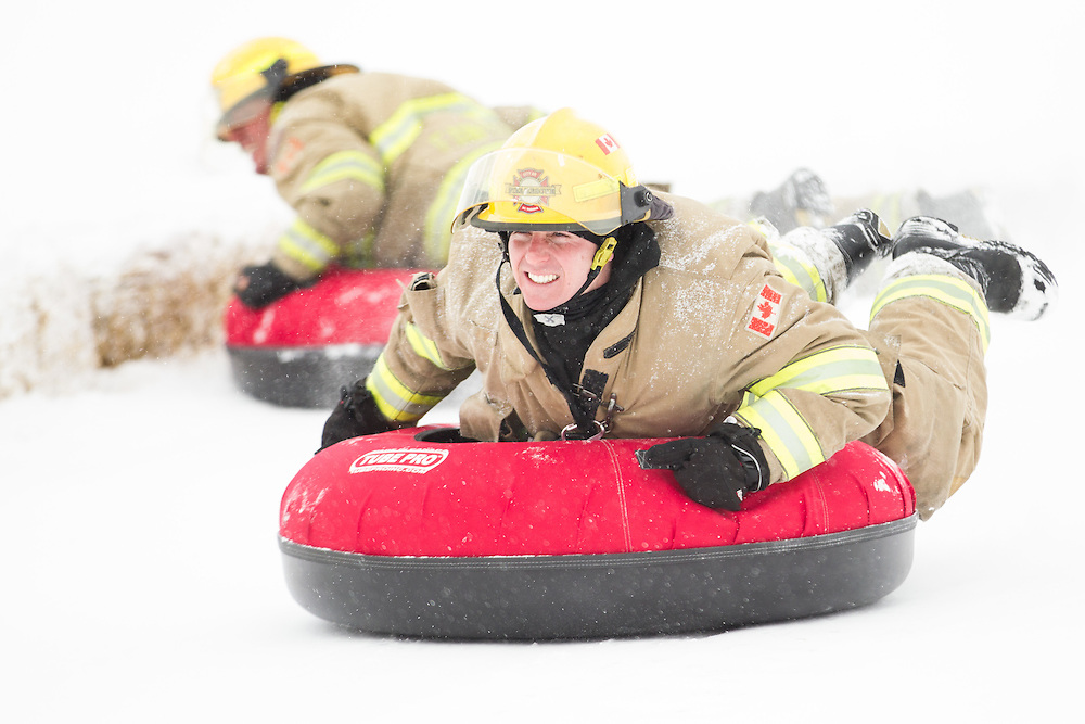 Firefighters from St. Thomas compete at the World Tubing Championship in St. Thomas, Ontario, February 13, 2016. The inaugural event, a fundraiser for the Special Care Nursery at the local hospital (St. Thomas Elgin General) attracted nearly 50 teams.<br /> AFP PHOTO/Geoff Robins