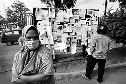 People put up images of missing loved ones outside a Kesdam Military hospital. Having survived a decades old  war between the Indonesian Military and GAM, Aceh is struck by a Tsunami on December 26th, 2004, claiming the lives of thousands.