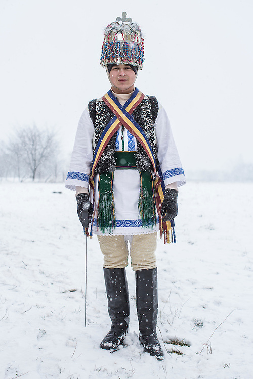 Dmytro Velia, 21, dressed in the costume of a tsar, poses for a portrait during celebrations of the Malanka Festival on Thursday, January 14, 2016 in Krasnoilsk, Ukraine. The annual celebrations, which consist of costumed villagers going in a group from house to house singing, playing music, and performing skits, began the previous sundown, went all night, and will last until evening.