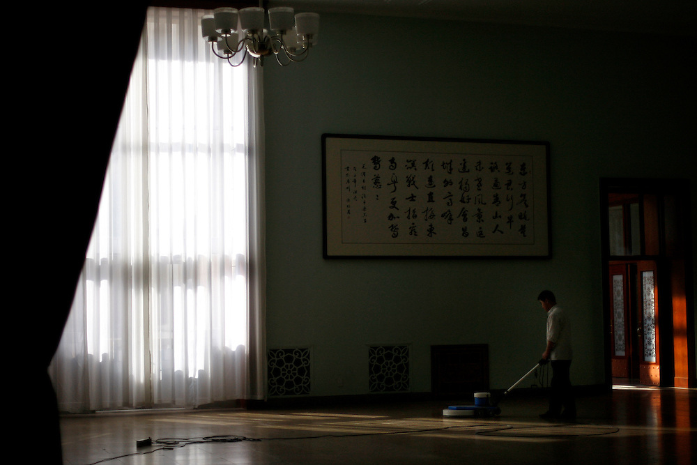 A Chinese worker polishes the floors of the Great Hall of the People ahead of the annual meeting of the Chinese legislature next week  in Beijing, China, Saturday, Feb.28, 2009. The Great Hall of the people's with it's impressive Stalinist building style and attention to protocol remains as one of the the country's last showcases  of old style communism on a grand scale.