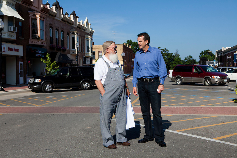 Republican presidential hopeful Tim Pawlenty, right, talks with a man after a campaign stop on Tuesday, July 26, 2011 in Washington, IA.