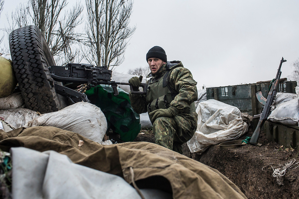 PIKSY, UKRAINE - NOVEMBER 19, 2014: Ivan, a member of the Dnipro-1 brigade, a pro-Ukraine militia, mans a 50-caliber machine gun along the front lines in Pisky, Ukraine. The village of Pisky is the scene of much of the front-line fighting over the Donetsk airport. CREDIT: Brendan Hoffman for The New York Times