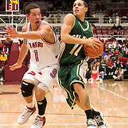 Cal Poly's Chaz Thomas gets around Stanford's Mitch Johnson during The Mustangs'  58-82 loss to The Cardinal.  November 28th, 2005