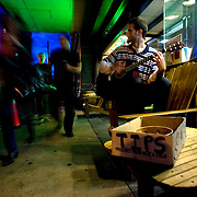 A street performer sets up his one man stage on the sidewalk of Historic Wilmington's downtown nightlife scene hoping for a few tips, but playing just to play.<br />