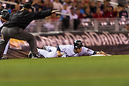Justin Morneau (33) of the Minnesota Twins is called safe at 3rd base by umpire Brian Runge on August 10, 2012 at Target Field in Minneapolis, Minnesota.  The Rays defeated the Twins 12 to 6.  Photo: Ben Krause