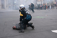 A member of the Montreal Police riot squad slams a protester to the ground during the May  Day demonstration in Montreal, the largest in recent history because of the presence of striking students. Montreal, May 1, 2012.