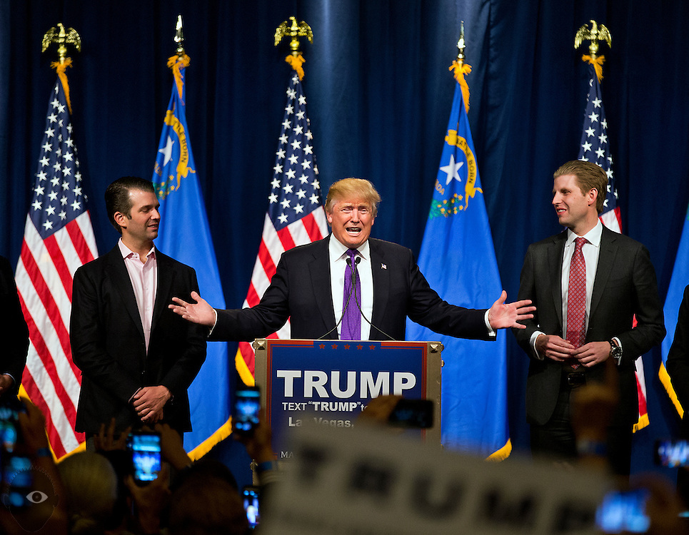 Republican presidential candidate Donald Trump with sons Donald Jr. (left) and Eric (right) speaks during a  watch party celebration for his Nevada caucus win at Treasure Island on Tuesday, February 23, 2016.   L.E. Baskow