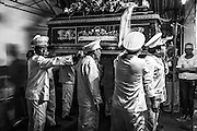 The last rites of a Catholic funeral in Saigon Vietnam.