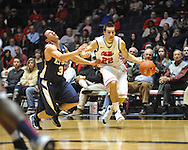 "Ole Miss' Marshall Henderson (22) fouls East Tennessee State's Mario Stramaglia (3) at the C.M. ""Tad"" Smith Coliseum in Oxford, Miss. on Saturday, December 14, 2012. Mississippi won 77-55 to improve to 7-1. (AP Photo/Oxford Eagle, Bruce Newman).."