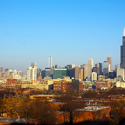 Chicago, IL Fall Skyline featuring the three major tall buildings in Chicago, the Willis (Sears) Tower, the Trump Tower, and the John Hancock Building all rising high over the surrounding city landscape.
