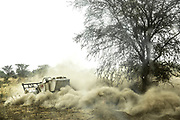 An UNMAS MineWolf 240 cuts an access lane in Rejaf East, South Sudan. The machine is operated remotely by technician, Mameer Akwer, from inside a Mine Protected Vehicle, which will protect him should the MineWolf detonate a mine or unexploded ordnance.<br /> <br /> Photo: UNMAS/ Martine Perret