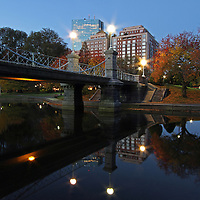 Boston twilight photography of the historic Boston Public Garden Lagoon Bridge photographed on a magical autumn morning in November.<br /> <br /> The bridge crossing the lagoon in the Boston Public Garden was designed by William G. Preston and opened in 1867. It was the shortest functioning suspension bridge in the world before its conversion to a girder bridge in 1921. Nowadays the original suspension system is purely decorative.<br /> <br /> This Boston fall foliage photography picture of the famous Boston Public Garden Lagoon Bridge is available as museum quality photography prints, canvas prints, acrylic prints or metal prints. Prints may be framed and matted to the individual liking and decorating needs:<br /> <br /> http://juergen-roth.artistwebsites.com/featured/historic-lagoon-bridge-at-the-boston-public-garden-juergen-roth.html<br /> <br /> All photographs are available for digital and print use at www.ExploringTheLight.com. Please contact me direct with any questions or request.<br /> <br /> Good light and happy photo making! <br /> <br /> My best, <br /> <br /> Juergen<br /> www.RothGalleries.com<br /> www.ExploringTheLight.com<br /> Twitter: @NatureFineArt<br /> Facebook: https://www.facebook.com/naturefineart