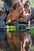 A hiker stops to take in the beauty of the East Fork of the Jemez River near Jemez Springs, New Mexico.