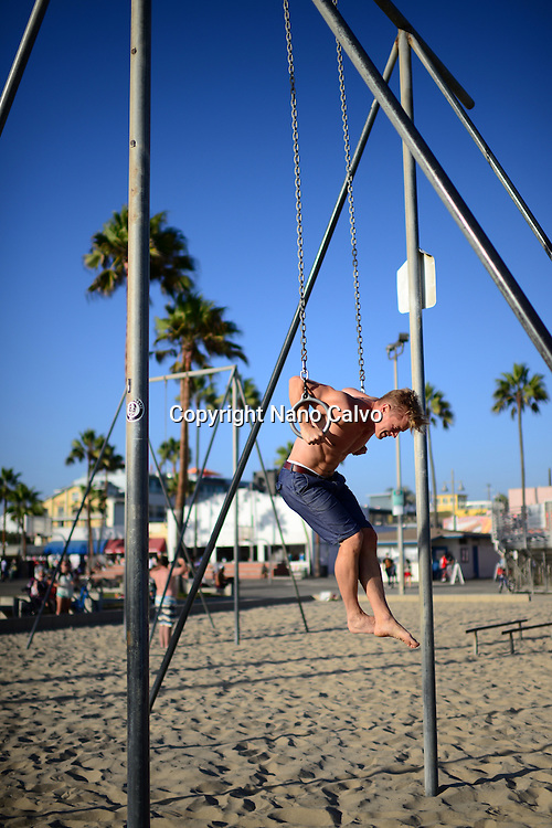 Young man training in Venice Beach Calisthenics park, California.