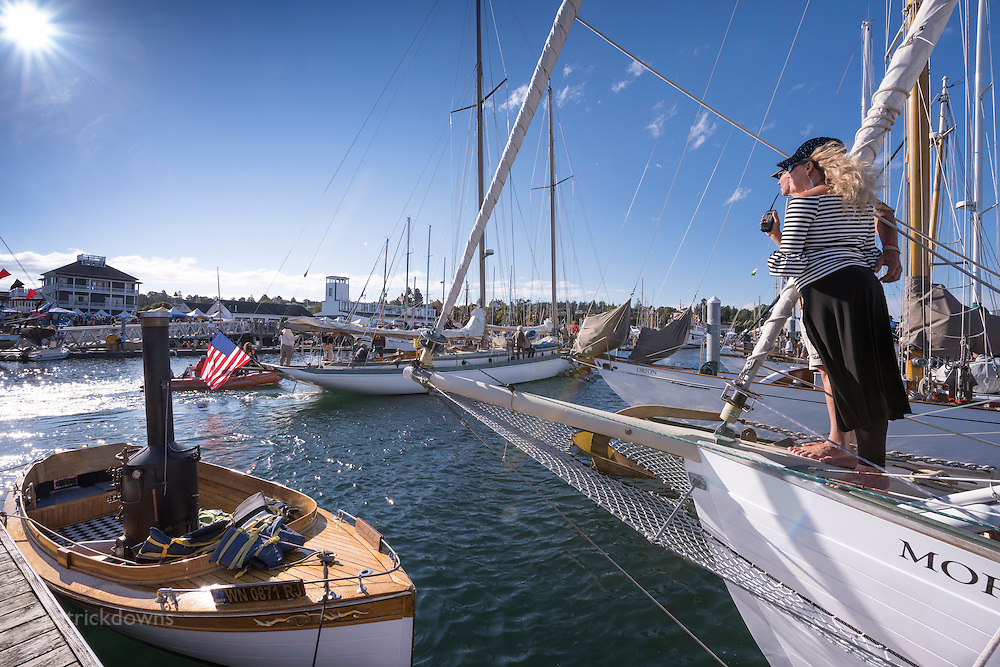 Wooden Boat Festival: A couple aboard the MorningStar watch as schooner Martha comes back in after the schooner race at the festival.<br /> (lighter version)
