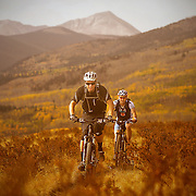 SHOT 9/23/12 1:53:04 PM -  Mountain biking the Colorado Trail near Kenosha Pass in Colorado as aspen leaves change colors. Kenosha Pass, elevation 9,997 feet, is a high mountain pass located in the Rocky Mountains of central Colorado in the United States.The pass is located in the Rocky Mountains just northeast of the town of Fairplay, Colorado. Aspens are trees of the willow family and comprise a section of the poplar genus, Populus sect. Populus. The Quaking Aspen of North America is known for its leaves turning spectacular tints of red and yellow in the autumn of the year (and usually in the early autumn at the altitudes where it lives). This causes forests of aspen trees to be noted tourist attractions for viewing them in the fall. (Photo by Marc Piscotty / © 2012)