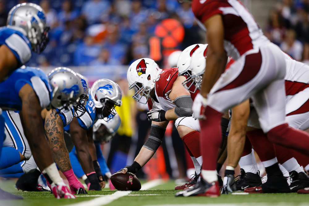 The Detroit Lions, left, face the Arizona Cardinals on the scrimmage line during the second half of an NFL football game, Sunday, Oct. 11, 2015, in Detroit. (AP Photo/Rick Osentoski)