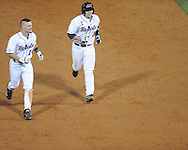Mississippi's Braxton Lee (11) runs around the bases with Austin Anderson (8) following Anderson's three run walkoff home run in the 13th inning against Auburn at Oxford-University Stadium in Oxford, Miss. on Friday, April 4, 2014. Mississippi won 8-5. Auburn was trying to intentionally walk Anderson, who slapped the game winning home run over the right field wall. (AP Photo/Oxford Eagle, Bruce Newman)