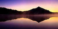 Mt. Crested Butte reflects in Peanut Lake. Crested Butte, Colorado.