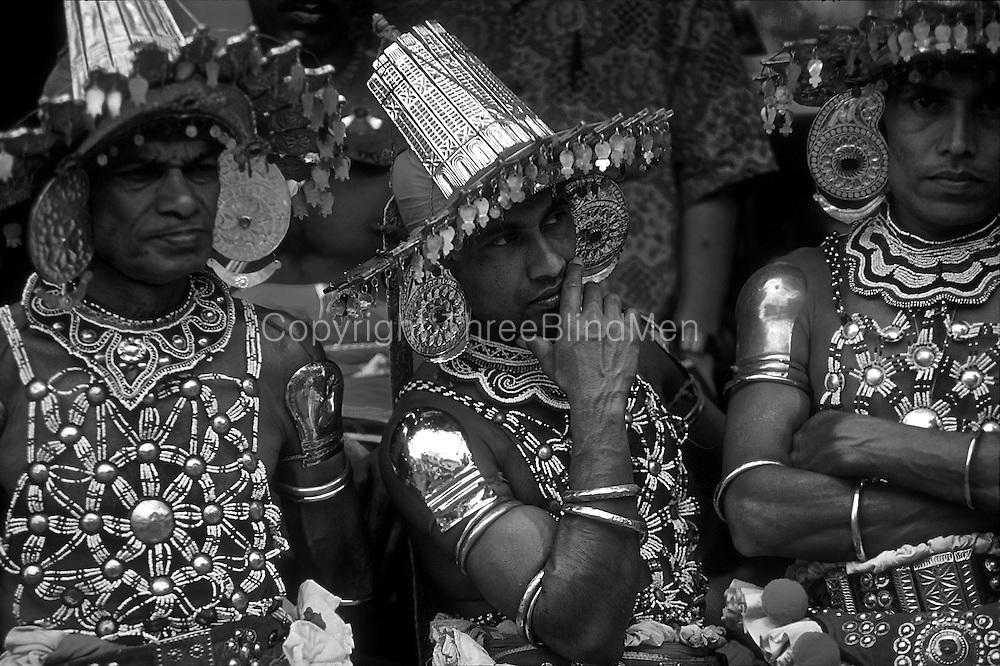 Dancers have a break at the Kandy Perahera.