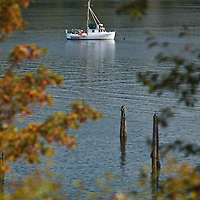 A gillnet fishing boat anchored in Port Gamble, Washington on Hood Canal, a major inlet on Puget Sound's western edge.