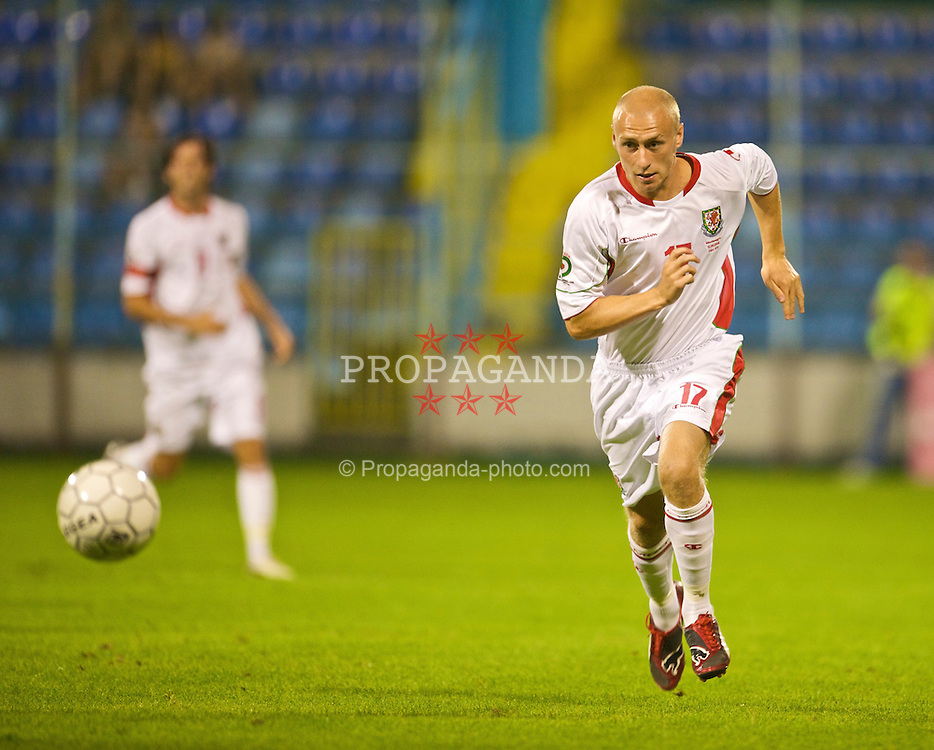 PODGORICA, MONTENEGRO - Wednesday, August 12, 2009: Wales' David Cotterill in action against Montenegro during an international friendly match at the Gradski Stadion. (Photo by David Rawcliffe/Propaganda)