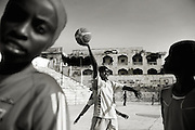 Suweys during practice - Death or Play. Women&acute;s Basketball in Mogadishu<br /> Women's basketball? In Europa and the U.S., we take it for granted. But consider this: In Mogadishu, war-torn capital of Somalia, young women risk their lives every time they show up to play.<br /> Suweys, the captain of the Somali women&acute;s basketball team, and her friends play the sport of the deadly enemy, called America. This is why they are on the hit list of the killer commandos of Al Shabaab, a militant islamist group, that has recently formed an alliance with the terrorist group Al Qaeda and control large swathes of Somalia.<br /> <br /> Al Shabaab, who sets bombs under market stands, blows up cinemas, and stones women, has declared the female basketball players &bdquo;un-islamic&ldquo;. One of the proposed punishments is to saw off their right hands and left feet. Or simply: shoot them.<br /> <br /> Suweys&acute; team trains behind bullet-ridden walls, in the ruins of the failed city of Mogadishu &ndash; protected by heavily armed gun-men. The women live in constant fear of the islamist killer commandos. Stop playing basketball? Never, they say.<br /> Women&acute;s basketball in the world&acute;s most dangerous capital. Female basketball in Mogadishu, Somalia.<br /> A deadly game..