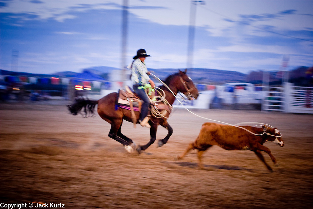 08 SEPTEMBER 2007 -- FT. DEFIANCE, AZ:  TANYA YAZZIE, from Gallup, NM, ropes a calf in breakaway roping at the All Women Rodeo in the Dahozy Stampede Rodeo Arena in Ft. Defiance, AZ, on the Navajo Indian Reservation. It was the first all women's rodeo on the Navajo Indian Reservation.  Photo by Jack Kurtz/ZUMA Press